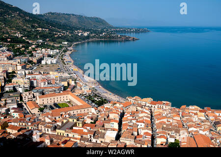 View of Cefalu town beach with the roofs of the Old Town in the foreground. Cefalu, Sicily, Italy, - Stock Photo