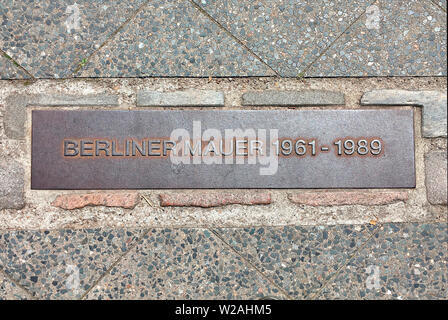Marking the course of the Berlin Wall at Potsdamer Platz in Berlin - Germany. - Stock Photo