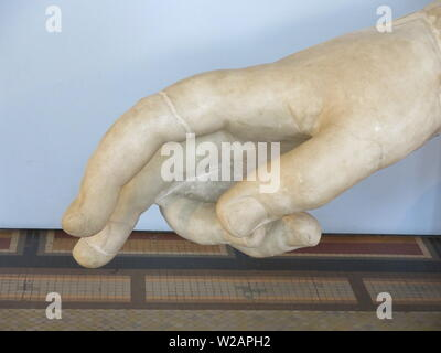 Close-up of a sculpted marble hand from the excavations of Ancient Roman on display at the Montemartini gallery in Rome - Stock Photo