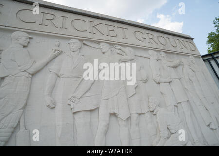 LONDON, ENGLAND - JULY 18, 2013: Outside Lords Cricket Ground wall sculpture In the London England suburb of St John's Wood on July 18, 2013. Lords is - Stock Photo