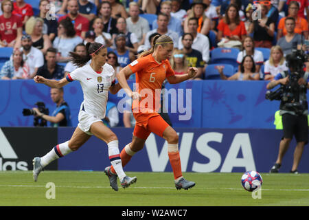 Groupama Stadium, Lyon, France. 7th July, 2019. FIFA Womens World Cup final, USA versus Netherlands; 13 Alex Morgan (USA) chases the run from Anouk Dekker (NED) Credit: Action Plus Sports/Alamy Live News - Stock Photo