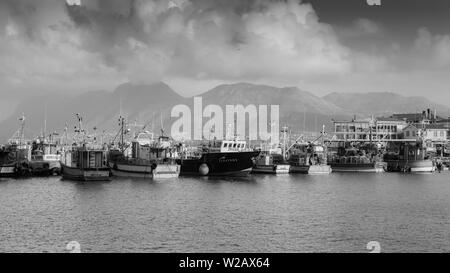 Kalk Bay fishing harbour on South Africa's False Bay coastline on the Cape Peninsula near Cape Town - Stock Photo