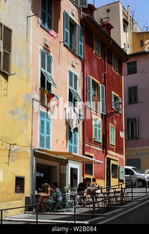 Old residential buildings in Vieille Ville (The Old Town) of Nice, France - Stock Photo