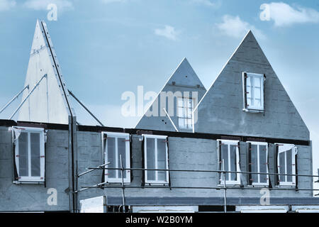 Gable house shell construction - New residential building under construction - Stock Photo