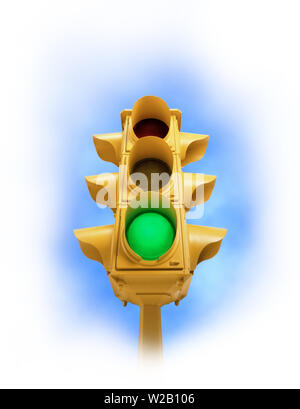Upward view of tall vintage yellow traffic signal with green light on white vignette background - Stock Photo