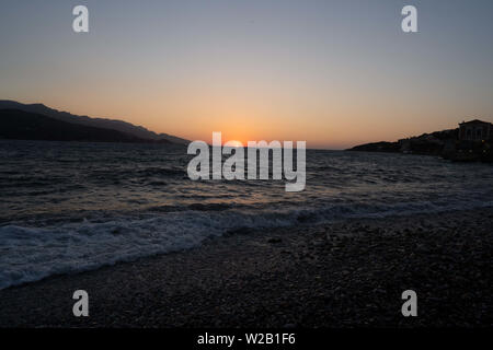 Samos, Samos, Greece. 29th June, 2019. The sea at the beach on Samos Town. The town is a short walk away from the refugee hotspot.Samos Island is one of Europe's migrant hotspots acting as a reception and identification centre (RIC). It was established as a temporary accommodation site where migrants could be processed before moving to a refugee camp on the mainland. However, due to the continued number of arrivals, the mainland camps are full and so migrants are being left at the islands. The conditions are inhuman as the Central Government has for several years ignored requests from the - Stock Photo