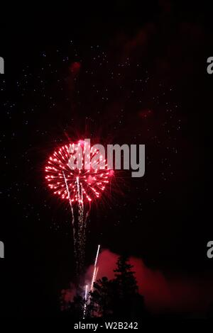 The fireworks display on the Fourth of July 2019 in Estes Park Colorado - Stock Photo