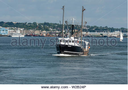 New Bedford, Massachusetts, USA - July 6, 2019: Commercial fishing vessel Freedom going scalloping on summer morning - Stock Photo