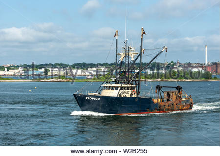 New Bedford, Massachusetts, USA - July 6, 2019: Commercial fishing vessel Tropico going scalloping on summer morning - Stock Photo