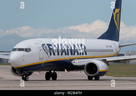 A Ryanair Boeing 737-800 taxis on the runway at Manchester Airport, UK. - Stock Photo