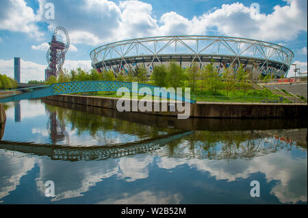 LONDON - APRIL 20, 2019: London Stadium reflects in one of the Bow Back Rivers, which were cleaned up when Stratford was revitalised for the  Olympics. - Stock Photo