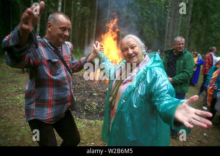 Russia. 07th July, 2019. PSKOV REGION, RUSSIA - JULY 7, 2019: People dance by a bonfire during the 60th Kurgan Druzhby meeting of Soviet Army veterans and guerrillas who fought against Nazi Germany during the Great Patriotic War (part of WWII) in 1941-1945 and who now live in Russia, Belarus and Latvia. Vladimir Smirnov/TASS Credit: ITAR-TASS News Agency/Alamy Live News - Stock Photo
