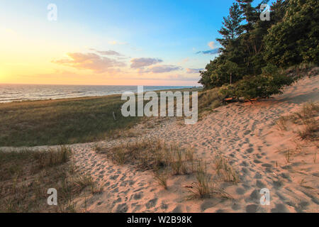 Beach Path. Winding path through dune grass and sand dunes on the shores of Lake Michigan. Hoffmaster State Park, Michigan - Stock Photo