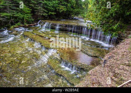 Wilderness Waterfall. Beautiful Au Train Falls is one of many waterfalls outside of Munising in Alger County, Michigan. - Stock Photo