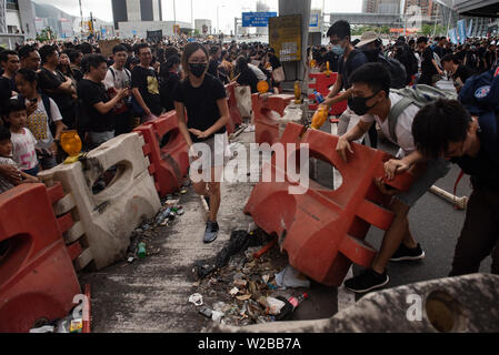 Hong Kong, China. 07th July, 2019. Protesters block a road off from traffic during the demonstration.Thousands of anti-government protesters marched and rallied to the West Kowloon High Speed Railway Station to demand the Hong Kong government to withdraw the extradition bill and to set up an independent commission to investigate on the police brutality while they used force to handle the protesters during the anti-extradition bill protests in June. Credit: SOPA Images Limited/Alamy Live News - Stock Photo