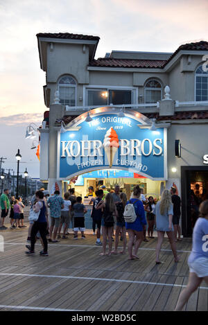 OCEAN CITY, NEW JERSEY/USA - JUNE 27, 2019: Tourists line up at a frozen custard stand on the famous Ocean City Boardwalk - Stock Photo