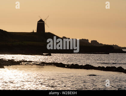 St Monans Windmill, St Monans, Fife, Scotland, UK. 8th July, 2019. UK weather - An idyllic early morning at St Monans Windmill, The East Neuk of Fife, Scotland. The windmill is one of the few reminders of the large scale salt production that took place here in the 18th century, when the windmill was used to pump sea water into the salt pans. Credit: Kay Roxby/Alamy Live News - Stock Photo