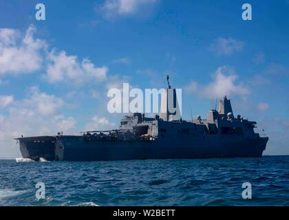 190625-N-HG389-0039 ROTA, Spain (June 25, 2019) An amphibious assault vehicle (AAV) departs the well deck of the San Antonio-class amphibious transport dock ship USS Arlington (LPD 24) to perform an agricultural wash-down at Naval Station Rota, Spain, June 25, 2019. Arlington is on a scheduled deployment as part of the Kearsarge Amphibious Ready Group in support of maritime security operations, crisis response and theater security cooperation, while also providing a forward naval presence. (U.S. Navy photo by Mass Communication Specialist 2nd Class Brandon Parker/Released) - Stock Photo