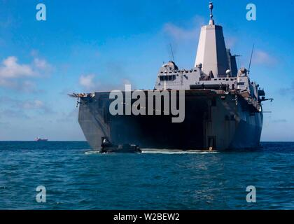 190625-N-HG389-0026 ROTA, Spain (June 25, 2019) An amphibious assault vehicle (AAV) departs the well deck of the San Antonio-class amphibious transport dock ship USS Arlington (LPD 24) to perform an agricultural wash-down at Naval Station Rota, Spain, June 25, 2019. Arlington is on a scheduled deployment as part of the Kearsarge Amphibious Ready Group in support of maritime security operations, crisis response and theater security cooperation, while also providing a forward naval presence. (U.S. Navy photo by Mass Communication Specialist 2nd Class Brandon Parker/Released) - Stock Photo