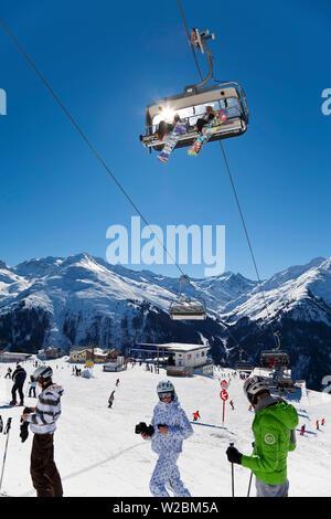 Europe, Austria, Tirol. St. Anton am Arlberg, fast modern chairlift - Stock Photo