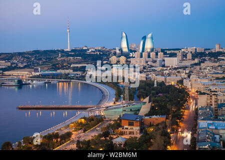 Azerbaijan, Baku, View of city looking towards The Baku Business Center on the Bulvur - waterfront in the distance are  Flame Towers and TV tower - Stock Photo