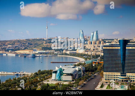 Azerbaijan, Baku, View of city looking towards Hilton Hotel, Park Bulvar shopping mall, Baku Business Center on the Bulvur - waterfront, in the distance are  Flame Towers and TV tower - Stock Photo