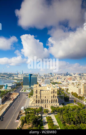 Azerbaijan, Baku, View of city looking towards Government House, Hilton Hotel, The Baku Business Center on the Bulvur - waterfront, in the distance are  Flame Towers and TV tower - Stock Photo