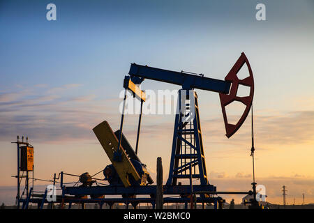 Azerbaijan, Abseron Peninsula, Oil Fields, typical oil pump jack know as a Nodding Donkey - Stock Photo
