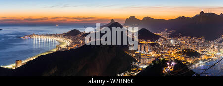 Mount Corcovado and the city at sunset from Sugarloaf (Pao de Acucar) in Rio de Janeiro, Brazil - Stock Photo