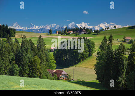 Emmental Valley and Swiss alps in the background, Berner Oberland, Switzerland - Stock Photo