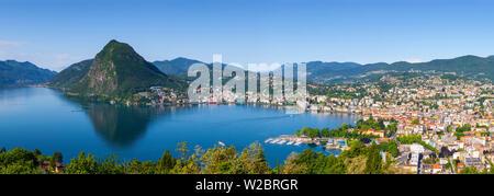 Elevated view over Lugano from Monte Bre, Lugano, Lake Lugano, Ticino, Switzerland - Stock Photo