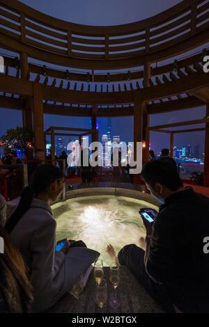 Vue bar at the Hyatt on the Bund, and Pudong skyline, Shanghai, China - Stock Photo