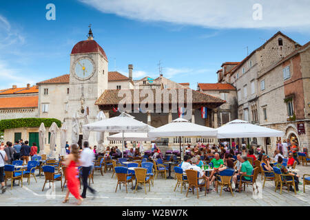 Town Hall Clock Tower & bustling central square, Stari Grad (Old Town), Trogir, Dalmatia, Croatia - Stock Photo