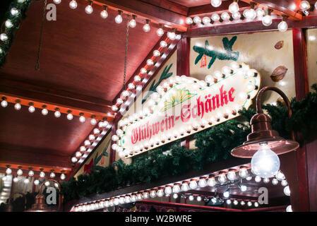 Germany, Berlin, Charlottenburg, Kurfurstendam, City Christmas market, sign for Gluhwein bar, selling mulled wine - Stock Photo