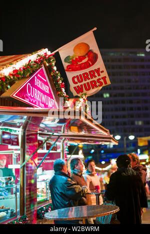 Germany, Berlin, Charlottenburg, Kurfurstendam, City Christmas market, curry wurst stand - Stock Photo