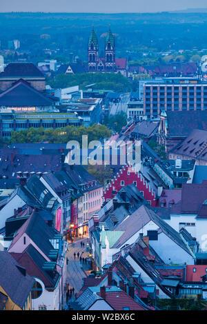 Germany, Baden-Wurttemburg, Black Forest, Freiburg-im-Breisgau, elevated city view from Schlossberg mountain, dusk - Stock Photo