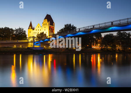 View across The River Danube towards New Palace iluminated at dusk, Ingolstadt, Upper Bavaria, Germany - Stock Photo