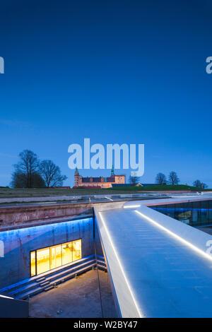 Denmark, Zealand, Helsingor, Danish Maritime Museum in underground drydock and Kronborg Castle, evening - Stock Photo