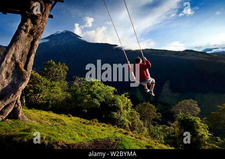 Swing At The End of The World, Tourist, Adventure Destination, La Casa Del Arbol, Treehouse Built To Monitor The Snow Covered And Very Active Tungurahua Volcano, Banos, Ecuador, Tungurahua Province - Stock Photo