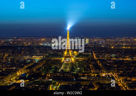 Elevated view of the Eiffel Tower, city skyline and La Defence skyscrapper district in the distance, Paris, France, Europe - Stock Photo