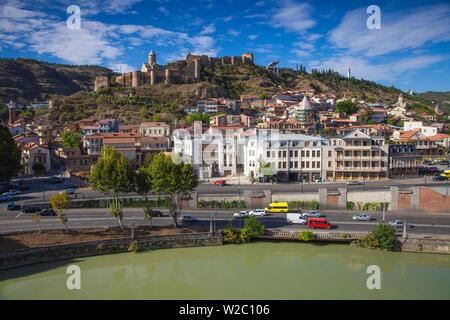 Georgia, Tbilisi, View over Mtkvari  (Kura) river towards Old Town and Narikala Fortress - Stock Photo