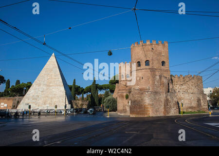Italy, Lazio, Rome, The Pyramid of Cestius and St. Paul's Gate and Museum of the Ostian Way - Stock Photo