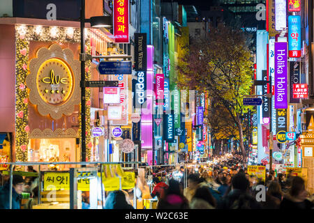 Myeong-Dong district at night. The location is the premiere district for shopping in the city - Stock Photo