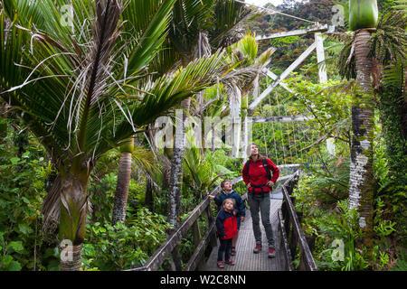 Family walking the Heaphy Track, Karamea, West Coast, South Island, New Zealand - Stock Photo