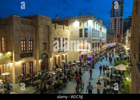 Souq Waqif busy with people in early evening, Doha, Qatar - Stock Photo