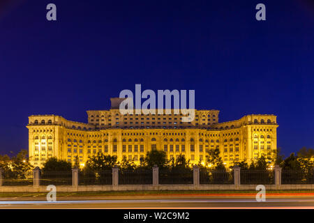 Romania, Bucharest, Palace of Parliament, world's second-largest building, dusk - Stock Photo