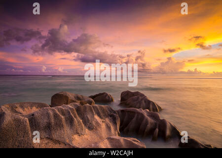 Praslin island from Anse Source d'Argent beach, La Digue, Seychelles - Stock Photo