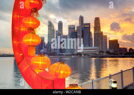 City Financial Skyline, River Hongbao decorations for Chinese New Year celebrations at Marina Bay, Singapore, South East Asia - Stock Photo