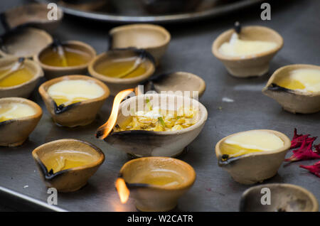 Singapore, Little India, Sri Veeramakaliamman Hindu Temple, votive candles - Stock Photo
