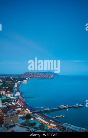 Ukraine, Crimea, Sudak View of city and Black Sea coast - Stock Photo